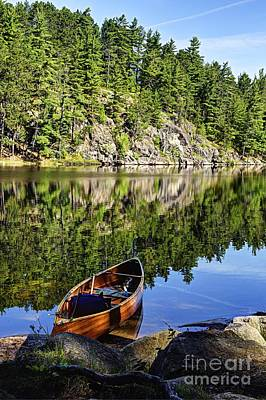 Photograph - Canoe At Slim Lake by Larry Ricker