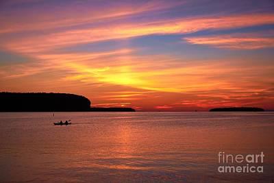 Photograph - Canoe At Sunset by Graesen Arnoff