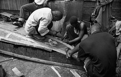 Photograph - Mending A Canoe by Muyiwa OSIFUYE