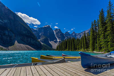 Photograph - Canoes At Moraine Lake by John Roberts