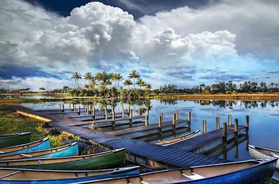 Canoes At The Docks Art Print by Debra and Dave Vanderlaan
