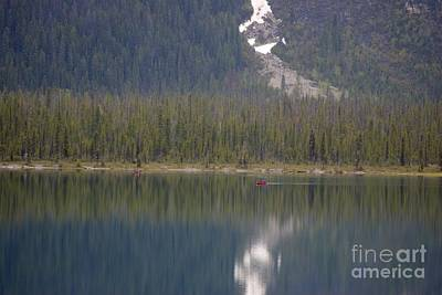 Photograph - Canoes On Emerald Lake by David Birchall