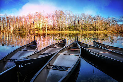 Photograph - Canoes On The River by Debra and Dave Vanderlaan