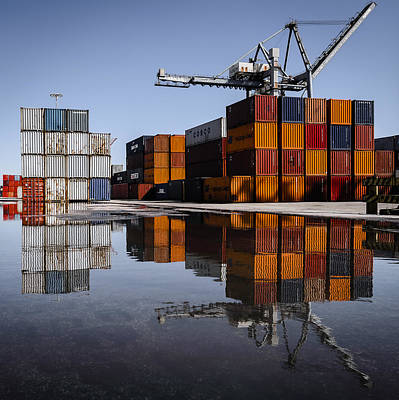 Cargo Containers Reflecting On Large Puddle Art Print by Marco Oliveira