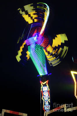 Photograph - Carnival Ride In Motion, The Texas State Fair by Greg Kopriva
