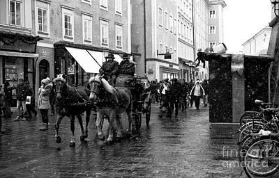 Photograph - Carriage Ride Through Salzburg by John Rizzuto