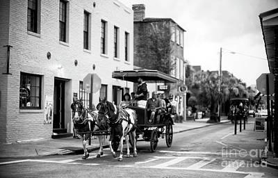 Photograph - Charleston Carriage Through City Market by John Rizzuto