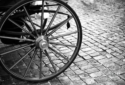 Photograph - Carriage Wheel In Rome by John Rizzuto