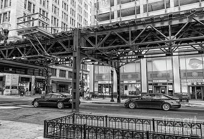 Photograph - Cars Driving Chicago Down Town Under Elevated Train Track by Patricia Hofmeester