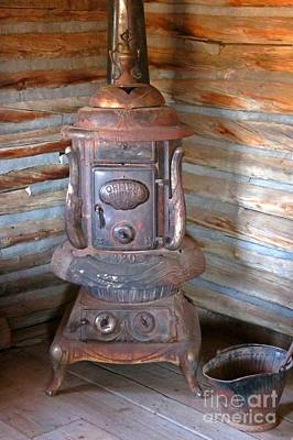 Cabin Interiors Mixed Media - Cast Iron Stove Of The Old West by John Malone