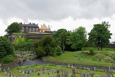 Castle And Cemetery Under A Cloudy Sky Art Print