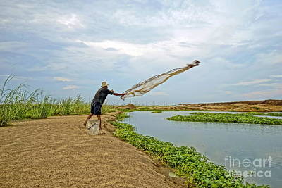 Photograph - Catch Fish by Arik S Mintorogo