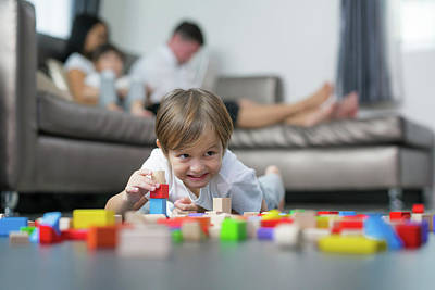 Photograph - Caucasian Boy Play Wooded Toy In Living Room In Home With His Father And Mother by Anek Suwannaphoom