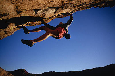 Overhang Photograph - Caucasian Climber Scaling An Overhang by Bobby Model