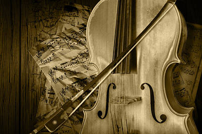Cello Stringed Instrument With Sheet Music And Bow In Sepia Art Print