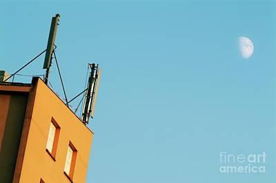 Cellular Phone Antennas And A Half Moon At Sunset Art Print by Sami Sarkis
