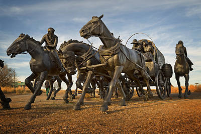 Covered Wagon Photograph - Centennial Statues by Ricky Barnard