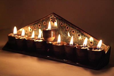 Photograph - Ceramic Chanukkiah Lit With Eight Lights And One Lighter, The Shamash, Viewed On The Side by Yoel Koskas