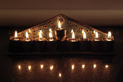 Photograph - Ceramic Chanukkiah Lit With Eight Lights And One Lighter, The Shamash by Yoel Koskas