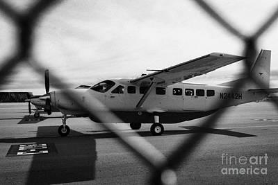 cessna 208B sightseeing tour aircraft at Grand canyon west airport Arizona USA Print by Joe Fox