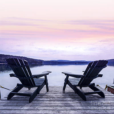 Landscapes Royalty-Free and Rights-Managed Images - Chairs on lake dock by Elena Elisseeva