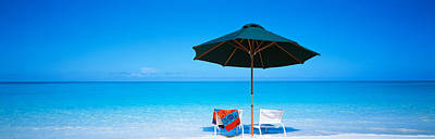 Turks And Caicos Islands Photograph - Chairs Under An Umbrella On The Beach by Panoramic Images