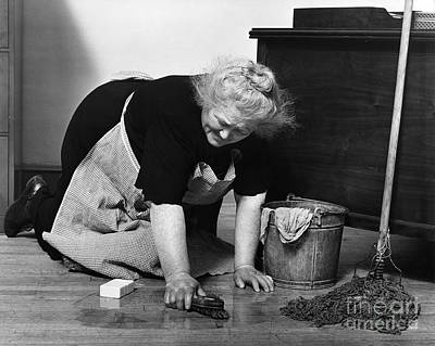 Charwoman Scrubbing Floor, C.1930s Art Print by H. Armstrong Roberts/ClassicStock