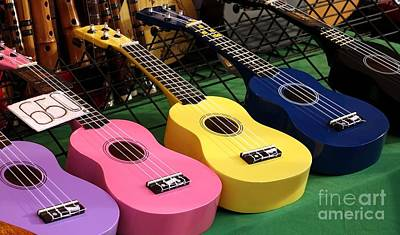 Photograph - Cheap Ukulele Instruments For Sale At A Market by Yali Shi