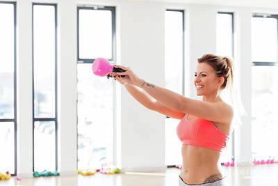 Athletic Photograph - Cheerful, Fit Woman Doing A Kettlebell Swing. by Michal Bednarek