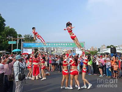 Photograph - Cheerleaders Perform Acrobatics by Yali Shi