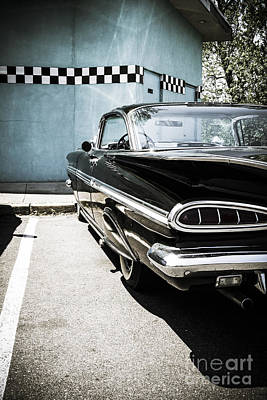 Chevrolet Impala In Front Of American Diner Art Print by Perry Van Munster