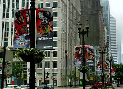 Photograph - Chicago Blackhawk Flags by Ely Arsha