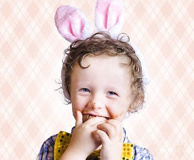 Child Eating Chocolate Easter Egg With Smile Print by Jorgo Photography - Wall Art Gallery