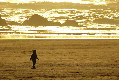 Photograph - Child On The Beach by Coby Cooper