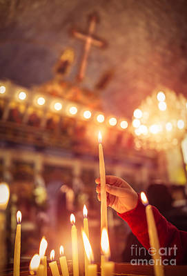 Photograph - Child Puts A Candle In The Church by Anna Om