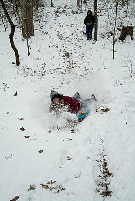 Child Sledding Down A Hill In The Snow Art Print by Todd Gipstein