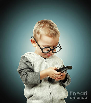 Photograph - Child With Remote Control by Gualtiero Boffi