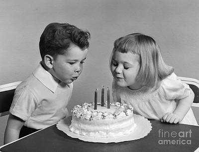 Children Blowing Out Birthday Candles Art Print by H. Armstrong Roberts/ClassicStock