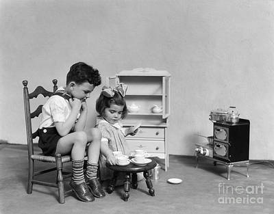 Little Sister Photograph - Children Having A Tea Party, C.1930s by H. Armstrong Roberts/ClassicStock