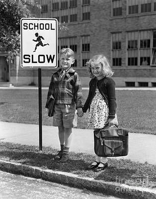 Photograph - Children Next To Slow Traffic Sign by H. Armstrong Roberts/ClassicStock