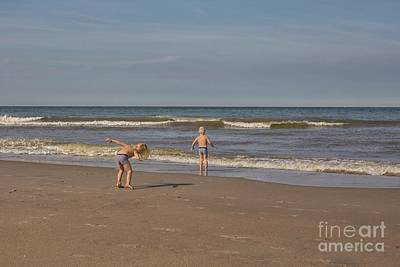 Photograph - Children Playing At The Seashore by Patricia Hofmeester