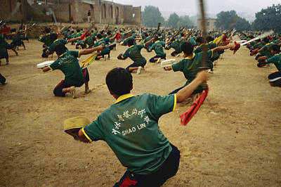 Chinese Architecture Photograph - Children Practice Kung Fu In A Field by Justin Guariglia