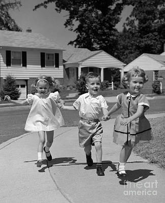 Little Sister Photograph - Children Skipping Down Sidewalk, C.1960s by H. Armstrong Roberts/ClassicStock