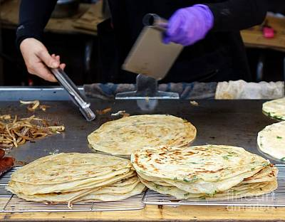 Photograph - Chinese Street Vendor Cooks Onion Pancakes by Yali Shi
