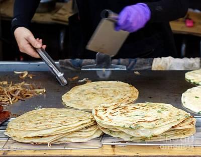 Photograph - Chinese Street Vendor Cooks Onion Pancakes by Yali Shi