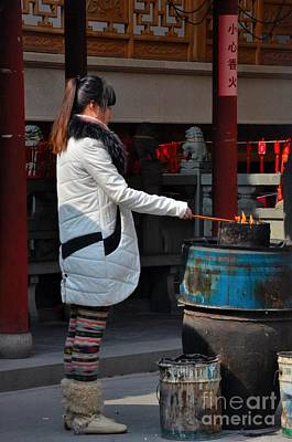 Photograph - Chinese Woman Burns Incense Offering At Taoist Temple by Imran Ahmed