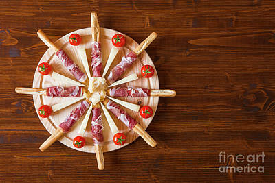 Wooden Platter Photograph - Chopping Board With Ham Rolled In Breadsticks Cheese And Cherry  by Luigi Morbidelli