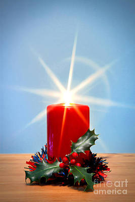 Christmas Candle With Starburst And Holly. Art Print by Richard Thomas