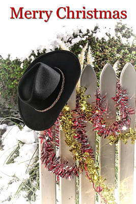 Photograph - Christmas Cowboy Hat On Fence - Merry Christmas  by Olivier Le Queinec