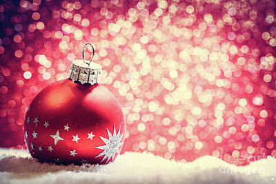 Glass Photograph - Christmas Glass Ball In Snow. Glitter Background by Michal Bednarek
